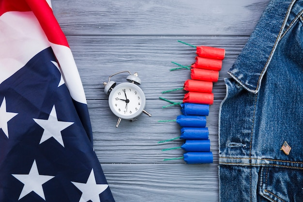 Flat lay of clock and usa attributes