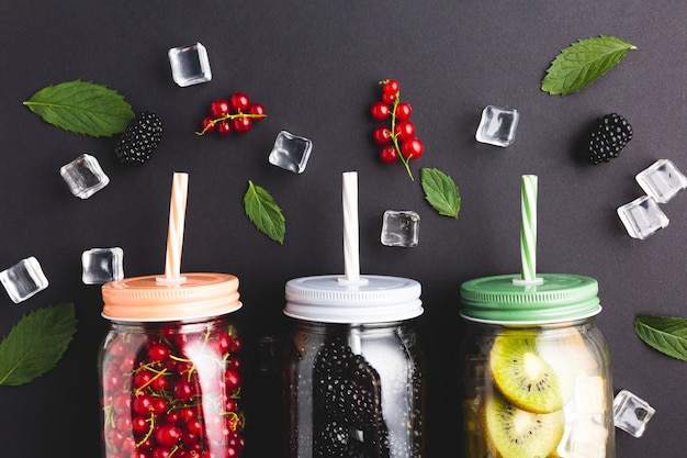 Flat-lay close-up mason jars with berries and kiwi