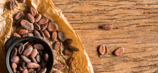 Flat lay cocoa beans in pot