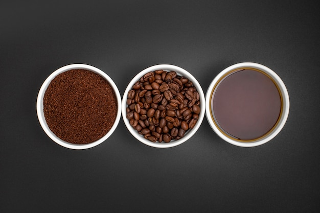 Flat lay coffee arrangement on black background