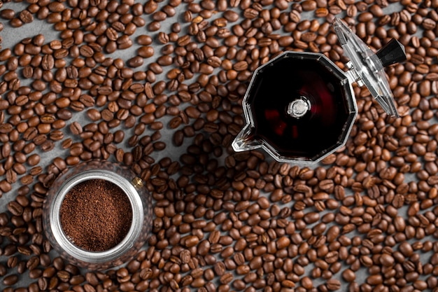 Flat lay coffee beans and powder in container