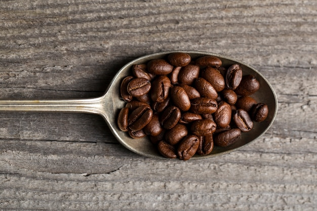 Flat lay coffee beans in spoon