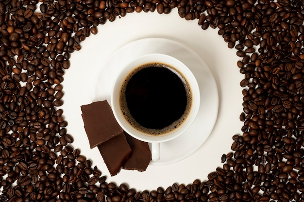 Flat lay coffee cup on beans background