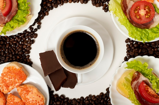 Flat lay coffee cup and protein breakfast arrangement