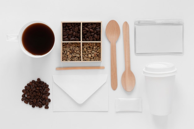 Flat lay coffee shop branding elements on white background