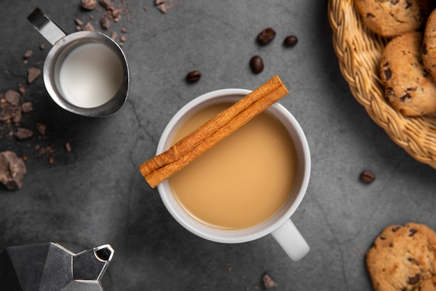 Flat lay coffee with cinnamon and cookies