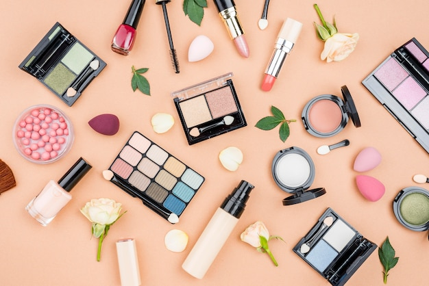 Flat lay collection of beauty products on beige background