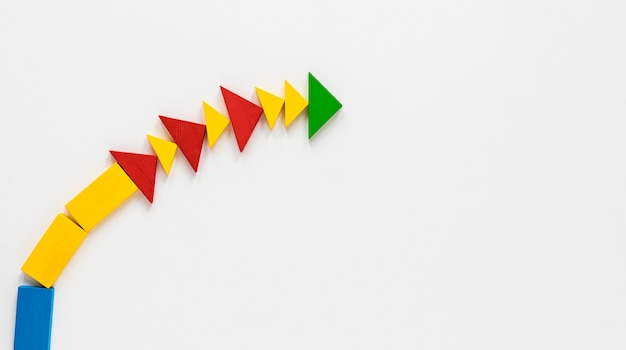 Flat lay colorful arrows in line on white background