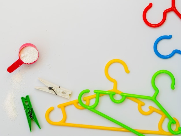 Flat-lay colorful clothes hangers with clothespins