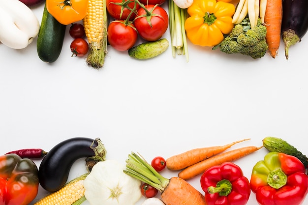 Flat lay colorful composition of vegetables with copy space