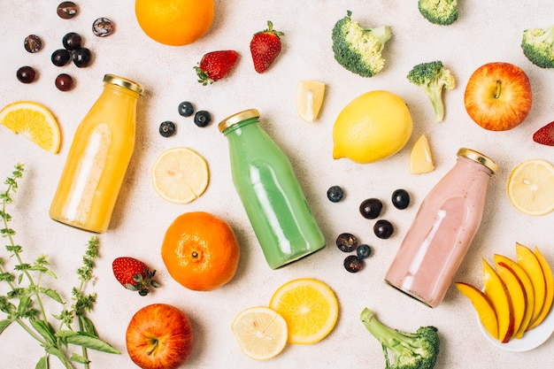 Flat lay colorful composition with smoothies and fruits