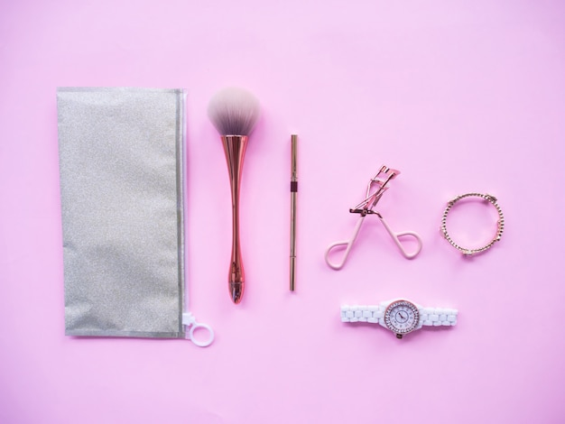 Flat lay colorful of cosmetic accessories with blank space for text.