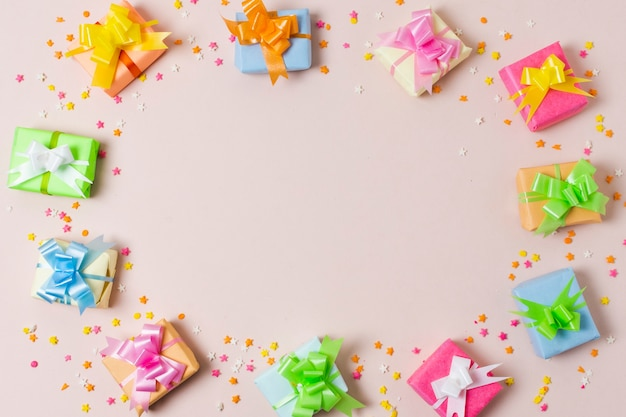Flat lay colorful gifts on table with copy space