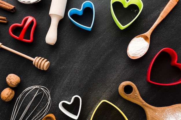 Flat lay of colorful heart shapes with of colorful heart shapes with kitchen utensils