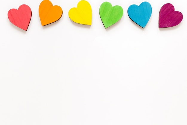 Flat lay colorful hearts with copy-space