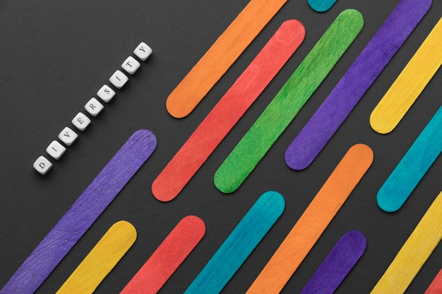 Flat lay colorful ice cream sticks composition