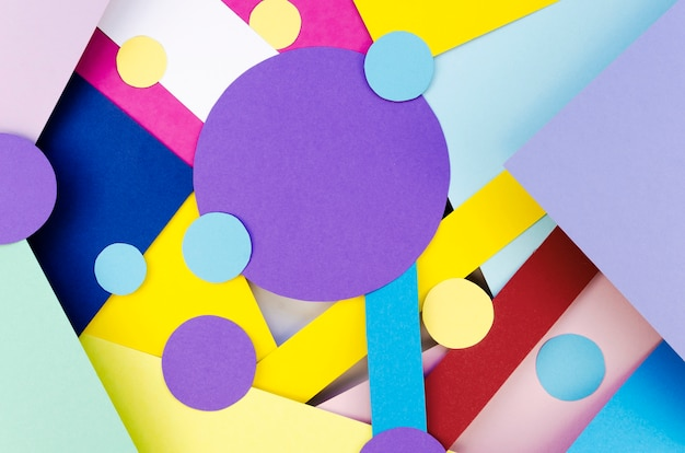 Flat lay of colorful paper circles and shapes