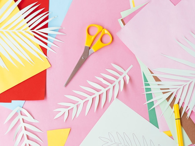 Flat lay of colorful paper and scissors