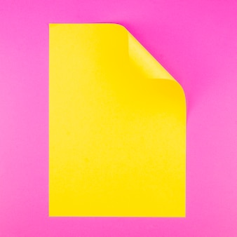 Flat lay of colorful paper sheet with twisted cornes