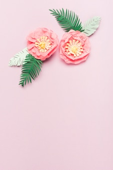 Flat lay of colorful paper spring flowers with leaves