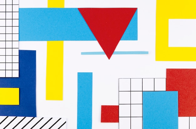 Flat lay of colorful paper triangles and shapes