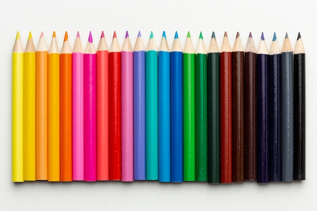 Flat lay of colorful pencils arrangement