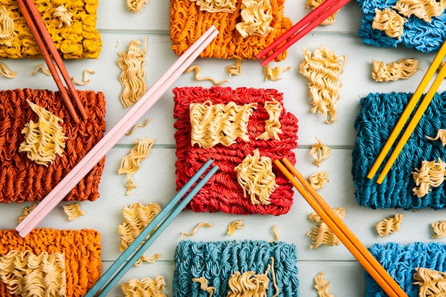 Flat lay colorful ramen noodles and chopsticks