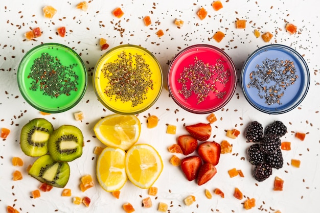 Flat lay colorful smoothies in glasses