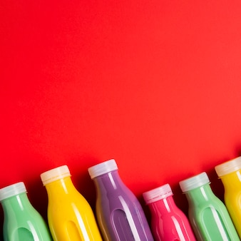 Flat lay colorful smoothies with copy space