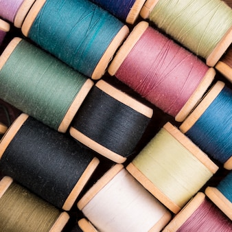 Flat lay of colorful thread spools