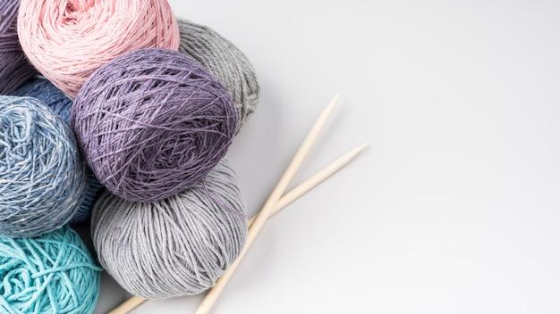 Flat lay of colorful wool yarn balls
