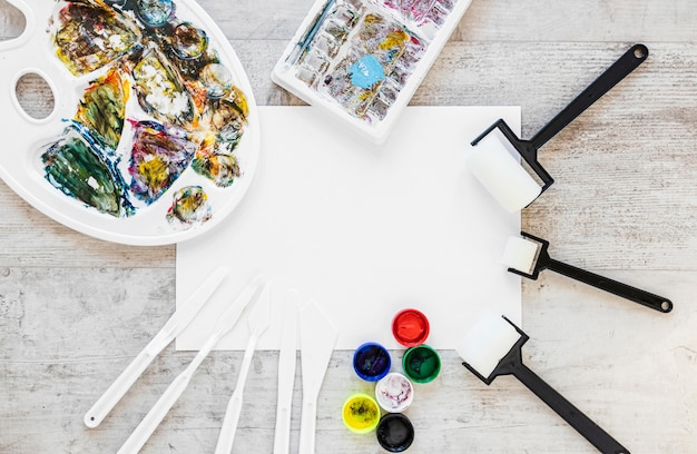 Flat lay colour tray palette and brushes