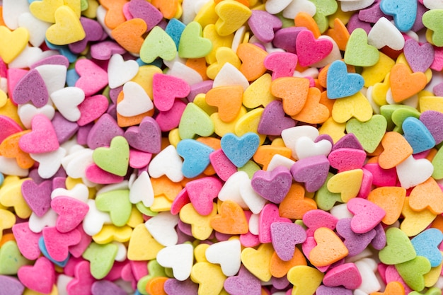 Flat lay of colourful heart-shaped candy