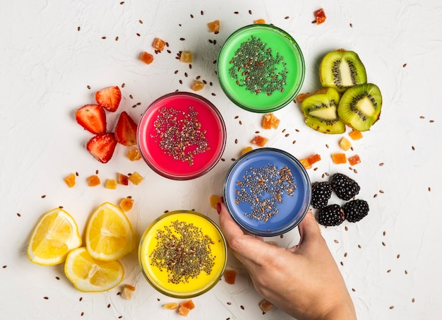 Flat lay colourful smoothies in glasses