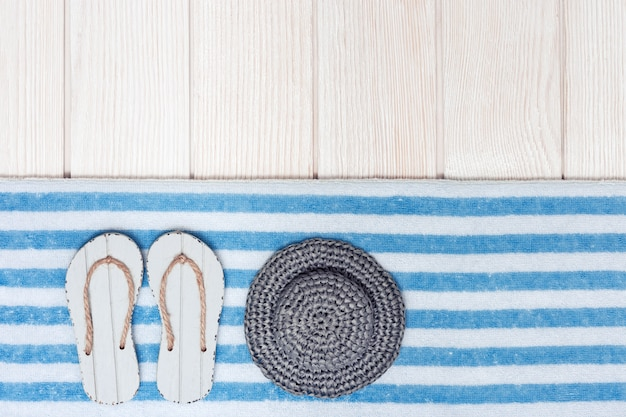 Flat lay of composed miniature of beach lounge area with summer shoes