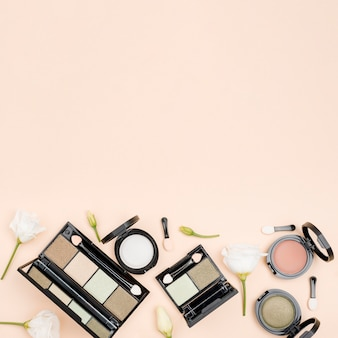 Flat lay composition of beauty products with copy space