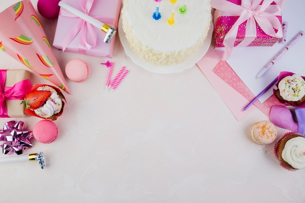 Flat lay composition of birthday elements with copyspace