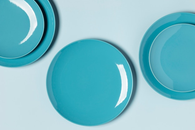 Flat lay composition of blue plates