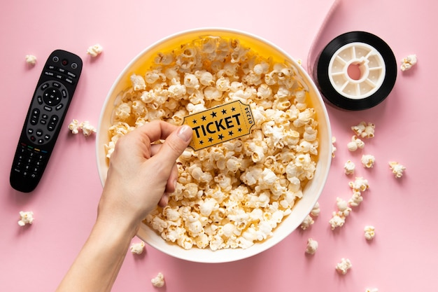 Flat lay composition of cinema elements on pink background