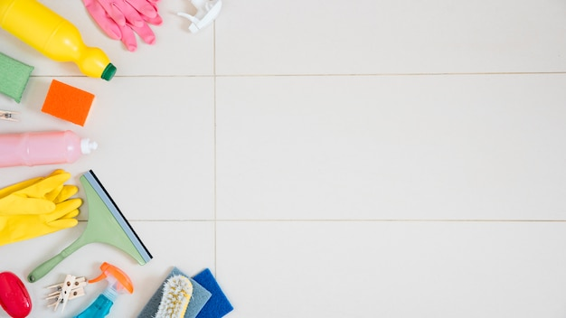 Flat lay composition of cleaning products with copyspace