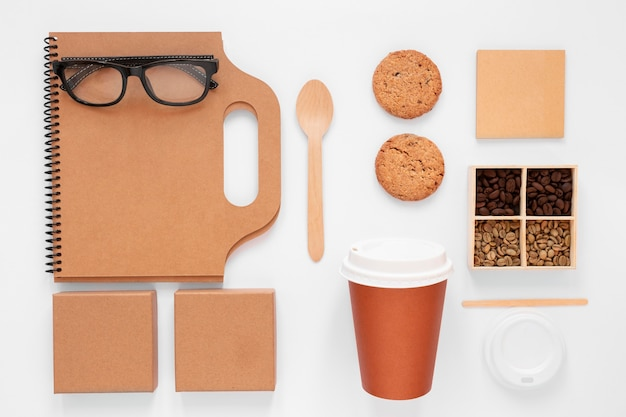 Flat lay composition of coffee shop branding elements