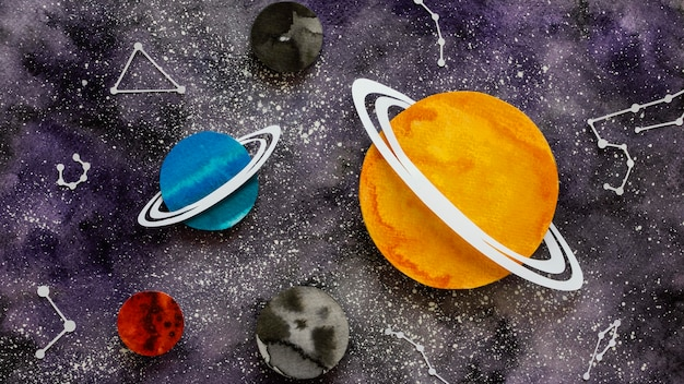Flat lay composition of creative paper planets