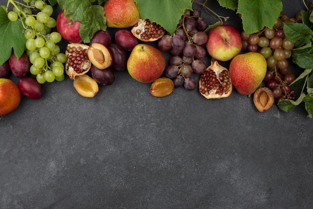 Flat lay composition of delicious autumn fruits with copy space