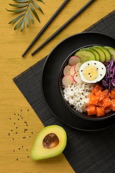 Flat lay composition of delicious poke bowl