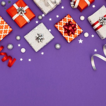 Flat lay composition of festive wrapped gifts with copy space