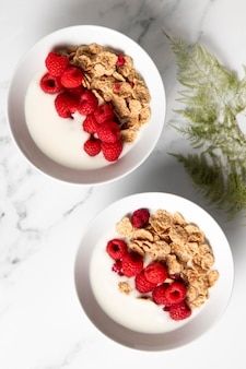 Flat lay composition of healthy bowl cereals