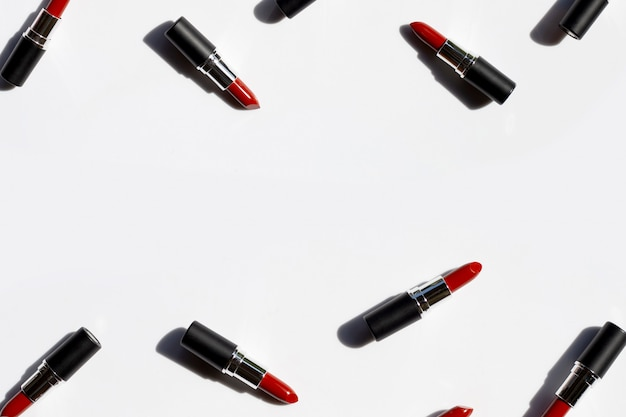 Flat lay composition, lipsticks on white background with shadow. beautiful make-up concept