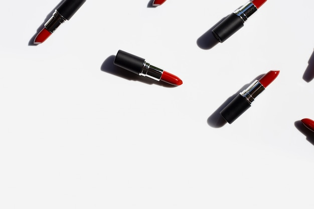 Flat lay composition, lipsticks with shadow. beautiful make-up concept