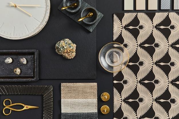 Плоская композиция творческой черной доски настроения архитектора с образцами строительных, текстильных и натуральных материалов, а также личными аксессуарами. вид сверху, черный фон, шаблон.