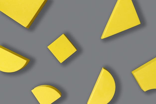 회색 배경에 노란색 기하학적 모양의 평평한 구성. 2021년 올해의 색상 팬톤 일루미네이팅과 얼티밋 그레이. 미니멀리즘 개념입니다.